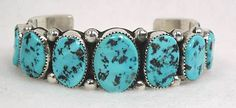 Authentic Native American Sterling Silver and Sleeping Beauty turquoise bracelet by Navajo Wilbur Muskett Jr.