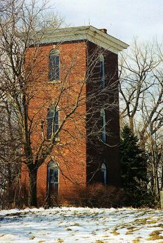 "Abandoned tower on old Route 25, north of Bowling Green, OH. This was built to house water tank for livestock & people. Brick walls 18"" thick helped to keep the water from freezing. The 1st floor had a boiler heated with natural gas piped from a well on the farm. There was a bathroom on the 2nd floor and an additional water tank on the 3rd floor, which caught runoff from the roof when it rained. There are many of these in NW Ohio. Often the rest of the farm is long gone but the towers remain."