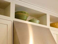 Kitchen storage area above cabinets... maybe instead of ripping out bulk head we could do something like this.