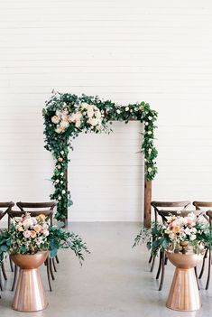 copper and green ceremony set up with a clean white backdrop