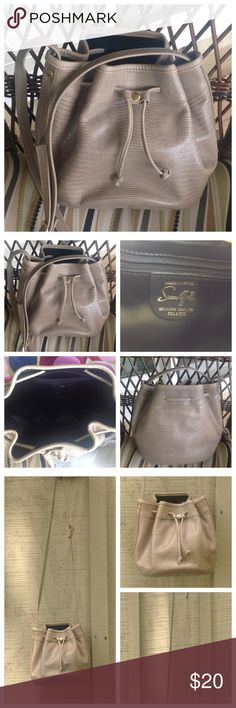 "Susan Gail Genuine Leather Bellido Hand Bag Susan Gail. Genuine leather Bellido. Made in Spain. Textured leather with round bottom, drawstring top, adjustable shoulder strap. Khaki tan color. Measures approximately 7L x 6W x 7""D. Excellent condition!! Susan Gal Bags Hobos"