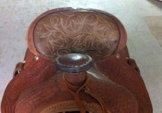HOW TO REPLACE A WESTERN SADDLE PADDED SEAT. Click on the SQUIDOO link to learn about replacing a padded seat. By Jerry Meece