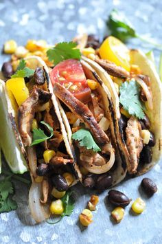 Small tacos with big taste! These black bean, shitake mushroom, and fresh corn street tacos are perfect for a light meal or as appetizers.