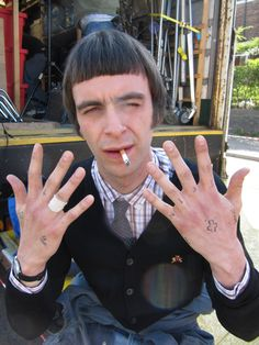 """this is england- Joe Gilgun showing off his fake tattoos for I think it's cool that he chose to get them really done. He has """"SINK"""" on his knuckles, a cross on a finger, and LOL on one hand in real life now. Dr. Martens, Skinhead Fashion, Skinhead Style, Joseph Gilgun, Joseph Williams, Glossy Eyes, The Right Stuff, Reggae Music, About Time Movie"""