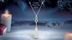 """AGRAFE PENDANT - by Cartier  WHITE GOLD, DIAMONDS, PEARLS    A tribute to Paris couture with a   motif inspired by the hooks and eyes   as used in the past. Cartier's brilliant   ""savoir-faire"" in fine jewellery."""