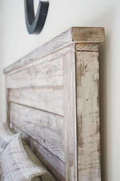 recycled wood headboard. Can't find it on the website but I really like the look.