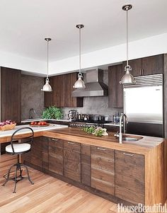 Warm wood tones with stainless steel, always a beautiful combination. Modern Wood Kitchen - Walnut Kitchen Cabinets - House Beautiful