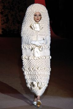 A white knitted cocoon makes the model look like a doll. Photo: A wedding dress designed in 1965 and showcased at Yves Saint Laurent's retrospective fashion show in Worst Wedding Dress, Ugly Wedding Dress, Crochet Wedding Dresses, Wedding Dress Fails, Horrible Wedding Dress, Funny Wedding Dresses, Tacky Wedding, Funny Weddings, Crazy Wedding