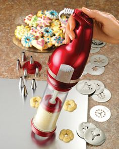 Electric Cookie Press  Features:   • Includes 12 cookie discs and 8 decorating tips  • Ergonomic handle with ON/OFF power button makes it easy to use  • Follow the included cookie recipes, or use store bought dough   • Can also be used for filling pasta shells, hard-boiled eggs or to decorate cupcakes and cakes $29.95