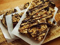 Oatmeal Protein Bars | A simple recipe with 10g of protein and 4g of fibre per bar. Easy to customize, and takes just 10 minutes to bake! A mixture of oats, nuts, seeds, dried fruit, bananas, dark chocolate and more. | www.ilovevegan.com