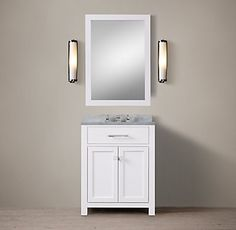 RH's Hutton Powder Room Vanity:This versatile collection brings a spare, Parsons-like sensibility to the bath.