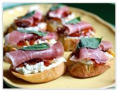 Prosciutto and Fig Crostini  1 fresh baguette 1/8 cup olive oil sea salt or kosher salt 4 ounces goat cheese, plain,  6 tablespoons Southern City Flavors fig jam 3 slices prosciutto, each cut in half  6 fresh basil leaves  Place six 1/2-inch slices of bread on a baking sheet and brush generously with olive oil. Salt lightly and bake at 375 degrees for about 10 minutes, or until crisp.   Spread on goat cheese. Then spread tbsp of fig jam. Next add prosciutto and basil leaf on top.
