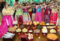 Children practicing bowing in respect to parents & grandparents--a tradition that is part of the Korean Chuseok or Harvest festival