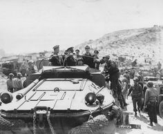 Supreme Allied Commander Dwight Eisenhower touring the Normandy invasion beaches with General George Marshall Admiral Ernest King and staff at St Laurent sur Mer 12 June 1944.