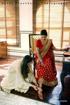 brides sister, bride getting ready , sister helping out , adjusting payal , paayal , pajeb , anklet