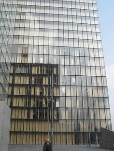 Moveable facade - shutters/doors behind glass - biblioteque nationale paris, Photo by Tom Spriggs