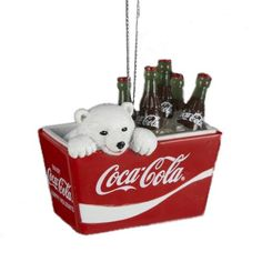 I absolutely love this cute polar bear cub Christmas tree ornament.   A coca-cola themed Christmas tree would certainly look festive, but even if you just had one or two of these ornaments on your tree they would look gorgeous.