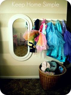Dress up space cool to have the dresses hung on a hook so they can see what there is and can also put it away no problem. Mirror is fun too.