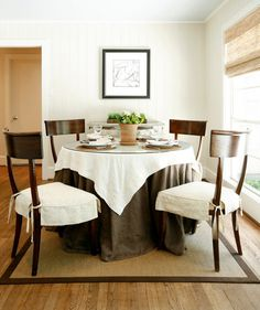 chocolate brown and white is classic and warm—and a glass top. Chairs should stay partially naked to give the table some leggy contrast.