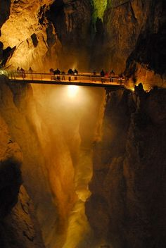 Skocjan Caves in Slovenia. One of the largest underground canyons in the world with the Reka river still carving through it. At 60 meters wide and 140 meters deep, this canyon is a fraction of the Grand Canyon's size, but the fact that it's all underground makes it feel bigger. When you cross the canyon via the narrow Hanke Canal Bridge, you'll see the roaring river far below.