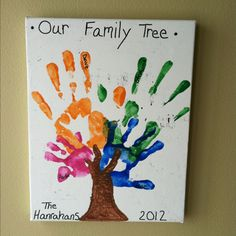 $5.00 canvas from Hobby Lobby, the kids paint, black Elmer's paint pen, and our hands made a cute and very cheap DIY family tree.
