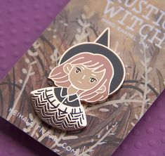 "A big bronze plated hard enamel pin of a Rustic Witch with two rubber clutches in the back.Size: 30mm x 35mm, 1,1"" x 2"""