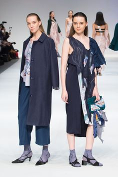 LOOKS 3 & 4 designed by Annie Mackinnon, The EcoChic Design Award 2015/16 finalist – Up-cycled and zero-waste panelled blue dress (right) & zero-waste hand-painted pleated corset and wool coat with woolen trousers (left) – all made from industry textile waste #Redress #ECDA #EcoChicDesignAwards #SustainableFashion #AnnieMackinnon