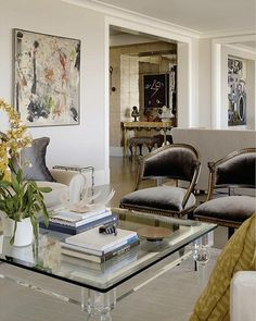 gorgeous, elegant shades of grays in silk and velvet, with cream,,,Lucite table and smoky mirrors add shimmer and luxe...abstract art adds sophistication..