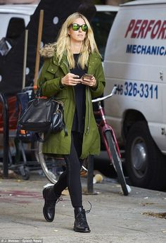 Green with envy: Nicky Hilton covered up her post-pregnancy figure with a green coat but still managed to showcase those slim limbs in tight black jeans on a solo stroll in NYC on Monday