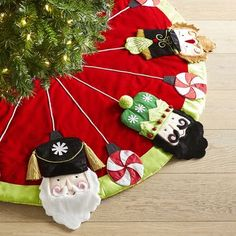 If you aren't already an avid nutcracker collector, you might want to start as three gleeful faces—and pops of peppermint—gather 'round your tree, adding a welcome touch of whimsy to your holiday festivities. Nutcracker Christmas, Christmas Angels, Christmas Home, Christmas Holidays, Christmas Crafts, Christmas Ornaments, Crochet Christmas, Unique Christmas Decorations, Holiday Decor