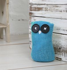 Use up scraps of yarn and make this knitted owl door stop as a quick home update. Simply knit a square and the rest is simple.