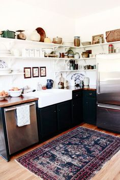 Black cupboards,white sink light wood floors open shelving.. This pic has it all