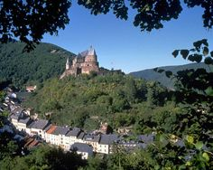 Vianden Castle, Luxemborg.  One of my most favorite places in the world.  Make sure you go when the walnut festival is going on.