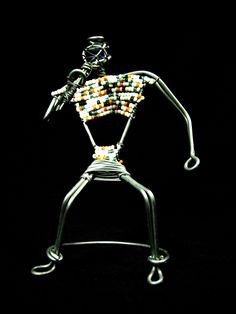 Wired For Sound! Amazing miniature musician figurine made from wire and beads. This one is a vocalist with a wireless microphone!