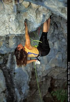 Women rock climber in yellow tank top hangs upside down while climbing a difficult rock. Climbing Girl, Sport Climbing, Ice Climbing, Mountain Climbing, Climbing Holds, Stock Pictures, Stock Photos, Rappelling, Extreme Sports