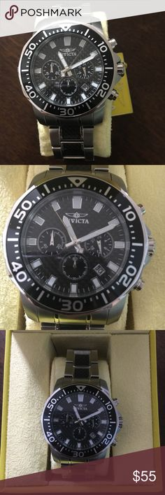 Invicta Men's Watch Invicta Pro Diver Chronograph Black Dial Two-tone Mens Watch. New with tags however the packaging has flaws. The yellow case has some discoloration and the envelope with the instructions is frayed. Watch is in perfect working condition. Invicta Accessories Watches