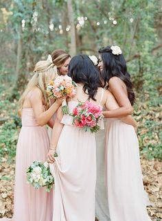 bridesmaids in pastel long pink dresses http://www.weddingchicks.com/2014/02/05/dos-pueblos-ranch-wedding-2/