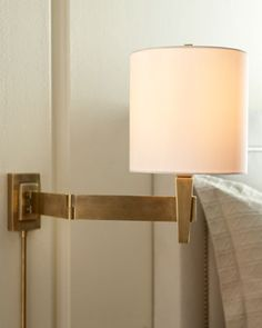 Shaded Sconce at Neiman Marcus.  master bedside