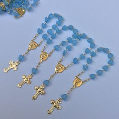 Mini rosaries perfect for baptism favors, heart shaped color blue and silver long approximately 3.5 - 4 4 long PLEASE NOTICE THAT THEY ARE NOT BRACELETS THEY ARE MINI AND USED ONLY FOR DECORATIONS Price is for 24 pieces. Only the rosaries does not include the bags. You can use