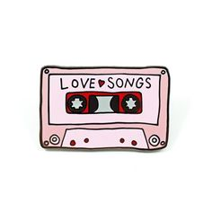 """Can you name two things that make the world go round? How about love and music?! Now you can rep both with this Love Songs Mixtape pin by Abby Galloway - 1.25"""" Hard Enamel - Design by Abby Galloway"""