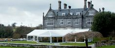 Frame marquee with clear roof bell extension on side @ Kitley House Hotel, Devon.