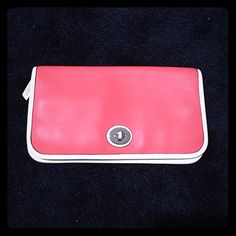 Coach coral clutch This is such a unique clutch! There is a tucked in pocket on top and a zipper pocket on the lower half. Comes with two smaller pockets. It does not zip shut, just folds over. Small pen mark on the inside. Otherwise in great condition. Coach Bags Clutches & Wristlets
