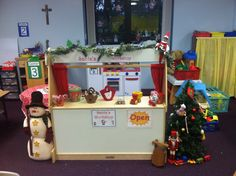 Pre-K Dramatic Play Area : Santa's Workshop. Fill the play area during December with anything you would find at the North Pole- Stockings, toys, wrapping paper, bows, gift bags, Christmas trees, cookies for Santa, etc! The kids have a ball with this!