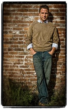 brown sweater, collared shirt and jeans