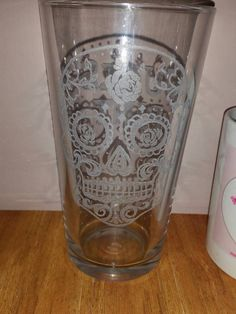 Check out this item in my Etsy shop https://www.etsy.com/uk/listing/245380250/sugar-skull-glass-choose-your-glass-free