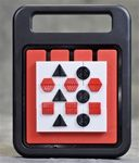 Slide, Twist'N Solve:  on the go puzzle.  Each shape has a raised pattern so it is easy to identify by touch, and the colors are high-contrast.  The solution key is on the back and can be recognized by touch.