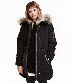 Check this out! Padded parka in woven fabric with a lightly brushed finish. Faux fur-lined hood with detachable trim, zip and wind flap at front with snap fasteners, and drawstring at waist and hem. Ribbing in cuffs. Side pockets with snap fastener, mock pockets with decorative zip, and pocket on one sleeve with zip. Slightly longer at back with a short slit center back. Lined. - Visit hm.com to see more.