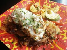 Coco Bolos ‏-  Evil Border Chicken 15.99 Sneak peek @ new menu item! Evil chicken smothered in chorizo, chz & tomatillo cream sauce. #Manhattan Kansas