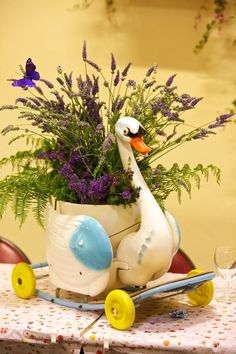 *who needs a hond on wheels when you can have a swan with added floral display? A good idea, makes me look at vintage toys a whole new way. I would enjoy this on my patio!