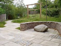 Give your garden a wild feel like this one which uses our Yellow Granite Paving, Yellow and Blue Setts and Yellow Quartz Paddlestones